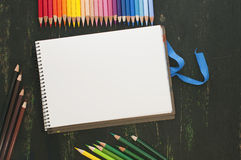 Color pencils and white paper Royalty Free Stock Photo