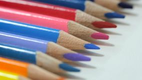 Color pencils on white table stock video footage
