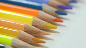 Color pencils on white table stock video