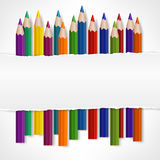 Color pencils and white torn paper Royalty Free Stock Photo