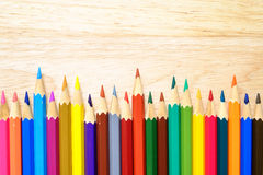 Color pencils on wood background royalty free stock image