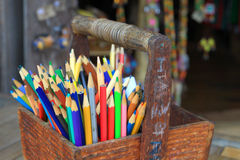 Color pencils in wood basket Stock Images