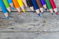 Color pencils on wood plank Royalty Free Stock Photos