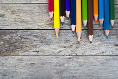 Color pencils on wood plank Royalty Free Stock Images