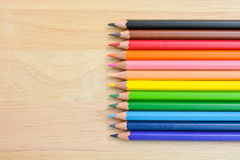 Color Pencils on wood texture. Background stock image