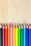 Color Pencils on wood texture. Background royalty free stock images