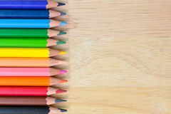 Color Pencils on wood texture. Background stock images