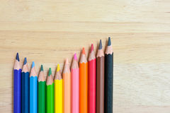 Color Pencils on wood texture. Background royalty free stock image