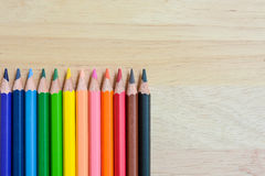 Color Pencils on wood texture. Background stock photo