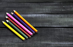 Color pencils on a wooden background with space for text Stock Photo