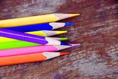 Color pencils on wooden floor. Closeup of color pencils on wooden floor stock images