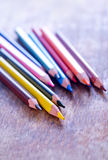 Color pencils. On the wooden table Royalty Free Stock Photos