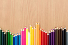 Color pencils on wooden table for background use. Color pencils on wooden background Stock Photo