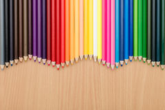 Color pencils on wooden table for background use. Color pencils on wooden Stock Images