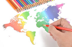 Color pencils and world map Royalty Free Stock Image