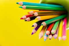 Color pencils. On yellow background Royalty Free Stock Photo