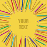Color pencils on yellow background Stock Photos