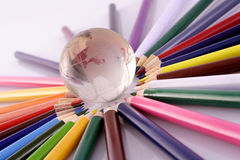 Color penicls and globe Stock Photo