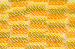 Color penne pasta. Tomato, spinach and wheat pastas. Stock Photography