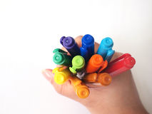 Color pens. A hand holding color pens for art creations Stock Images