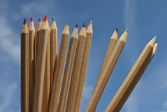 Color pens. Used color pens with blue sky in the background royalty free stock photos