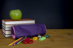 back to school concept. stack of books and pencils over wooden d stock photos