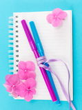 Color pens on a notebook. Color pens on top of notebook stock photography