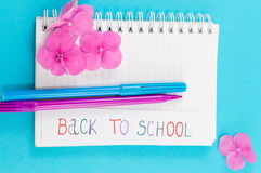 Color pens on top of notebook and back to school note. Color pens on top of notebook Royalty Free Stock Image