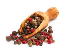 Color pepper in a wooden scoop Royalty Free Stock Image