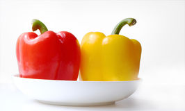 Color peppers on the plate Royalty Free Stock Photo