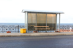 Bus stop on sea Stock Image