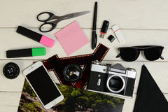 The color photo, the camera, markers, sticker, photoaccessories, shots of a film, flash card of memory and scissors on a table Royalty Free Stock Photography
