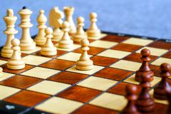 Color photo of chess Board and chess pieces, wooden chess pieces on the chessboard. Soft focus. Stock Photography