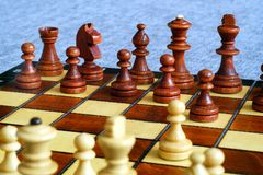Color photo of chess Board and chess pieces, wooden chess pieces on the chessboard. Soft focus. Royalty Free Stock Photo