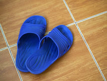 CLOSEUP OF RUBBER SANDAL ON FLOOR Stock Images