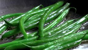 Color photo of green beans in a metal pan stock photography