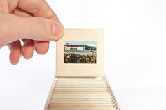 Color photo slide. Hand holding a 35mm color photo slide stock photos