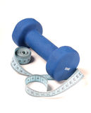 Dumbbells and ruler Stock Photos