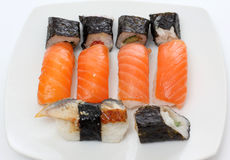 Red and black sushi on plate Stock Photography