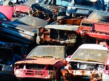 Color photography of cars junkyard. Color detail photo of old damaged rusty cars on junkyard Stock Image
