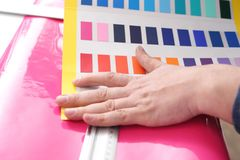 Interior design. The architect adjusts the color of the paint Stock Photo