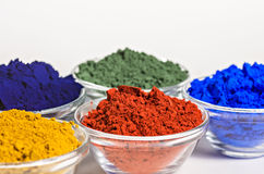 Color pigments in glass bowls royalty free stock photos