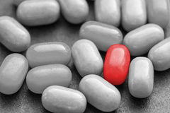 Color pill over many dark ones. Royalty Free Stock Photos