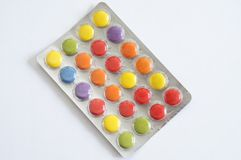 Color pills. Colorful pills in packaging Stock Photos