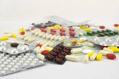 Color pills in bags on a white surface Royalty Free Stock Photography