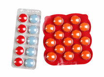 Color pills in a blister pack on white Stock Images