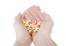 Color pills in a hand isolated Stock Photos