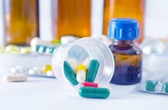 Color pills and medical bottle Royalty Free Stock Photos
