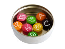 Color pills in metallic pillbox Stock Photos