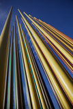 Color pipes. Multi-color pipes reaching for the sky as part of a paint shop display royalty free stock photos